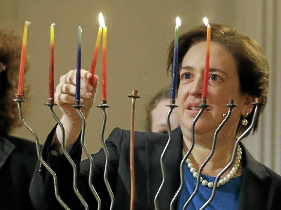 Supreme Court Justice Elena Kagan lights a menorah before speaking at the 6th & I Historic Synagogue in Washington. Photo: Alex Brandon — The Associated Press   / AP
