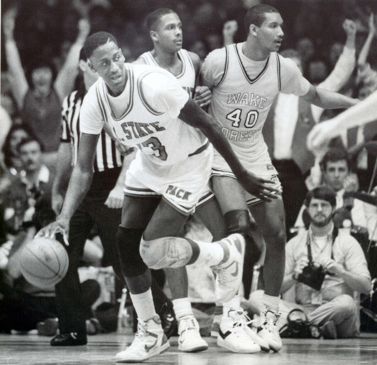 In this March 6, 1988 photo, North Carolina State NCAA college basketball player Charles Shackleford, left, plays against Wake Forest during a game in Raleigh, N.C. Shackleford, a North Carolina State basketball star in the 1980s who spent six seasons in the NBA, was found dead in his home on Jan. 27, 2017 in Kinston. He was 50.