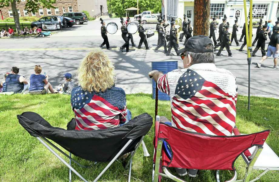 Nancy Roberto, left, and her husband, Tony, watch the Milford Memorial Day Parade go by on River Street in Milford last year. Photo: Arnold Gold — New Haven Register