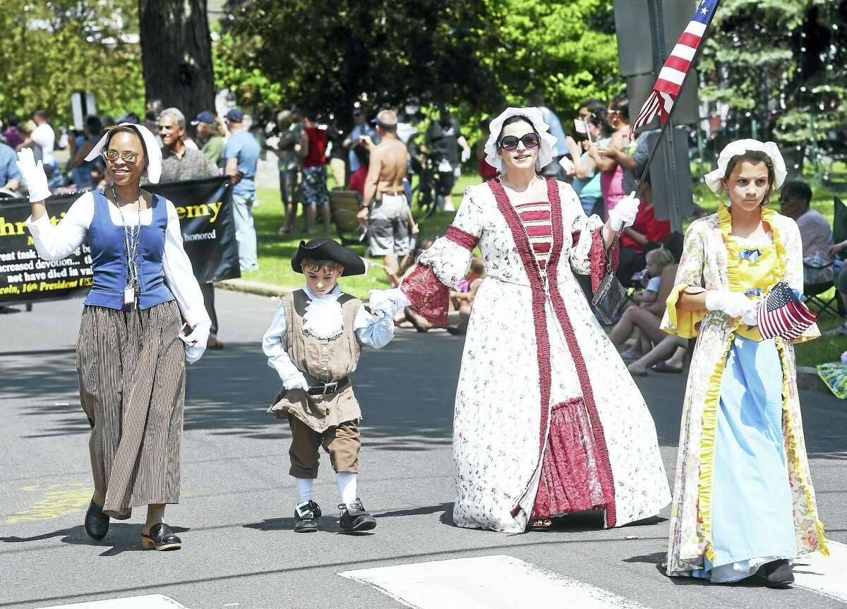 Women and children march in the Milford Memorial Day Parade last year.
