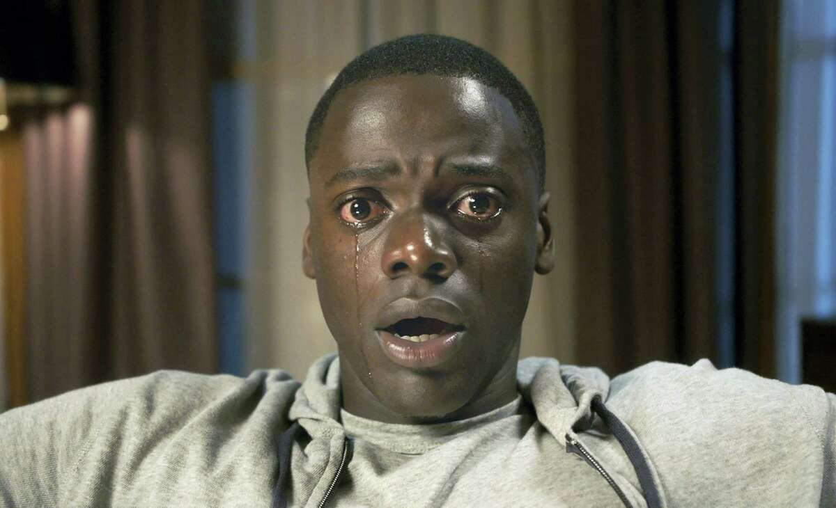 """This image released by Universal Pictures shows Daniel Kaluuya in a scene from, """"Get Out."""" (Universal Pictures via AP)"""