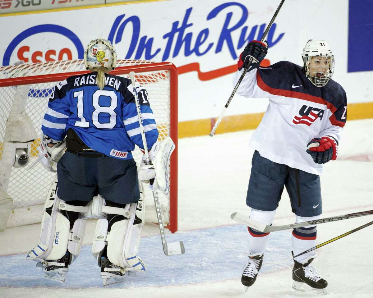 In this March 29, 2016 photo, United States' Hilary Knight celebrates after scoring against Finland goaltender Meeri Raisanen during a women's world hockey championships game in Kamloops, British Columbia. The U.S. women's national team says discussions with USA Hockey over an ongoing wage dispute were productive and will continue this week. The team released a statement March 20, after a lengthy meeting that included almost 20 players and top executives from USA Hockey. Players announced last week they'd boycott the upcoming world championships in Plymouth, Michigan unless significant progress was made toward a labor agreement.