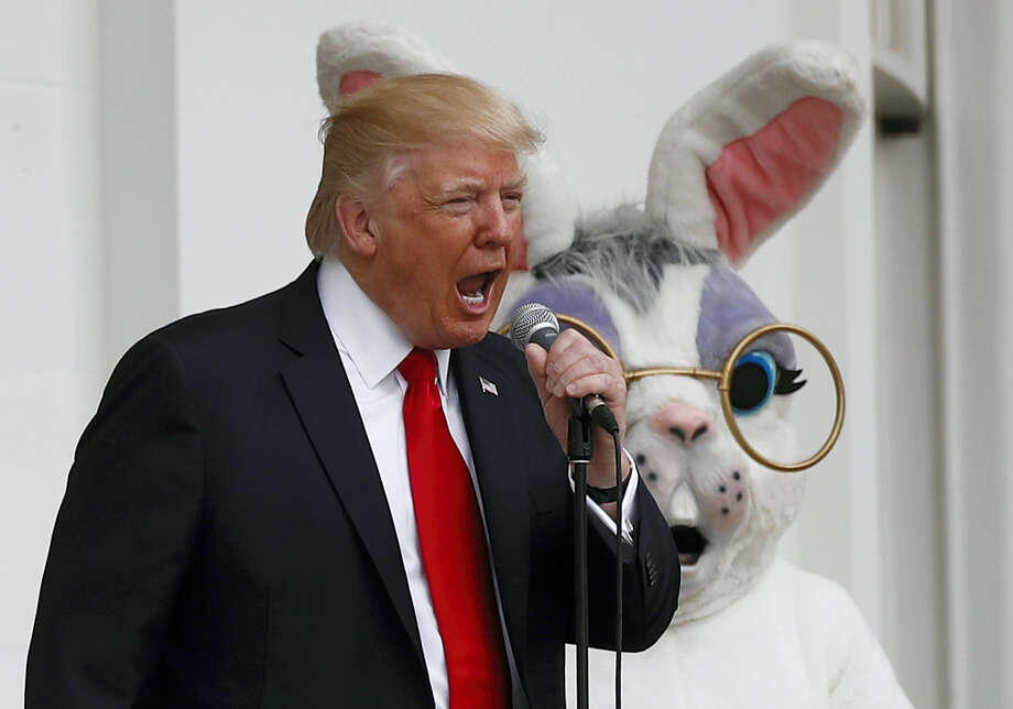 President Donald Trump, joined by the Easter Bunny, speaks from the Truman Balcony during the annual White House Easter Egg Roll on the South Lawn of the White House in Washington on April,17, 2017. Photo: AP Photo — Carolyn Kaster   / Copyright 2017 The Associated Press. All rights reserved.