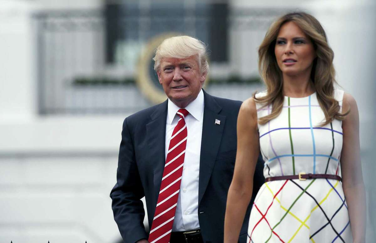 In this June 22, 2017, photo, President Donald Trump with first lady Melania Trump arrives at the Congressional Picnic on the South Lawn of the White House in Washington. Melania Trump ended her estrangement from Washington when she moved to the White House earlier this month and reunited with President Donald Trump after nearly five months apart. So what's next now that she's finally here? The below-the-radar first lady packed quite a bit into her first weeks as a full-timer at the White House, without being overtly public about it.