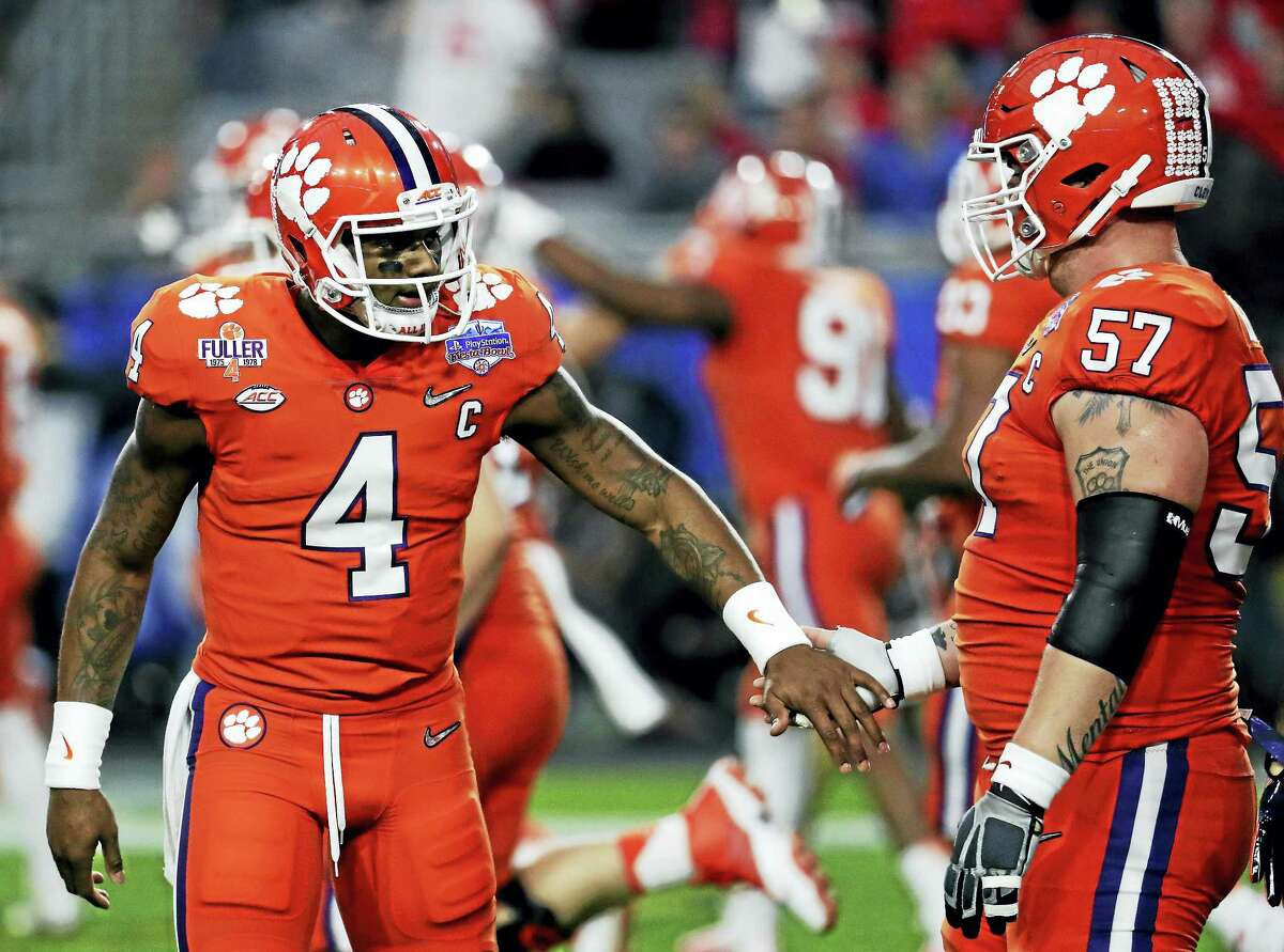 The Associated Press file photo Clemson quarterback Deshaun Watson (4) and Jay Guillermo (57) congratulate each other during the Fiesta Bowl.