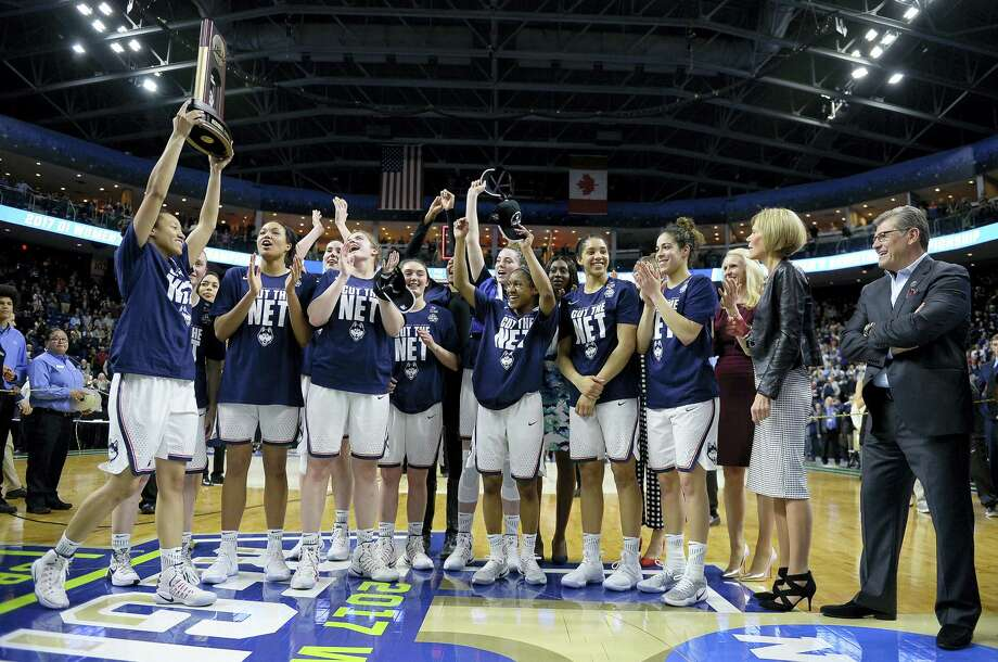 UConn's Saniya Chong holds the trophy as her teammates cheer following their 90-52 win over Oregon in the NCAA Tournament regional final in Bridgeport on Monday. Photo: Jessica Hill — The Associated Press   / AP2017
