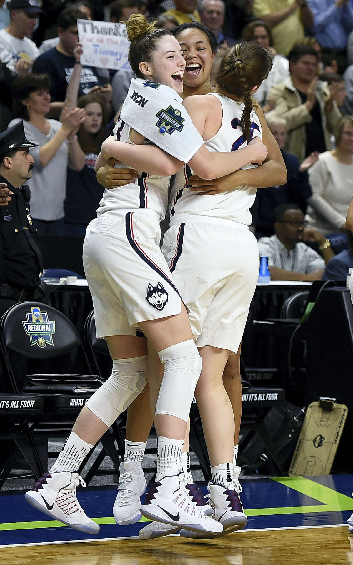 From left, UConn's Katie Lou Samuelson, Napheesa Collier and Kyla Irwin celebrate as the clock winds down on Monday.