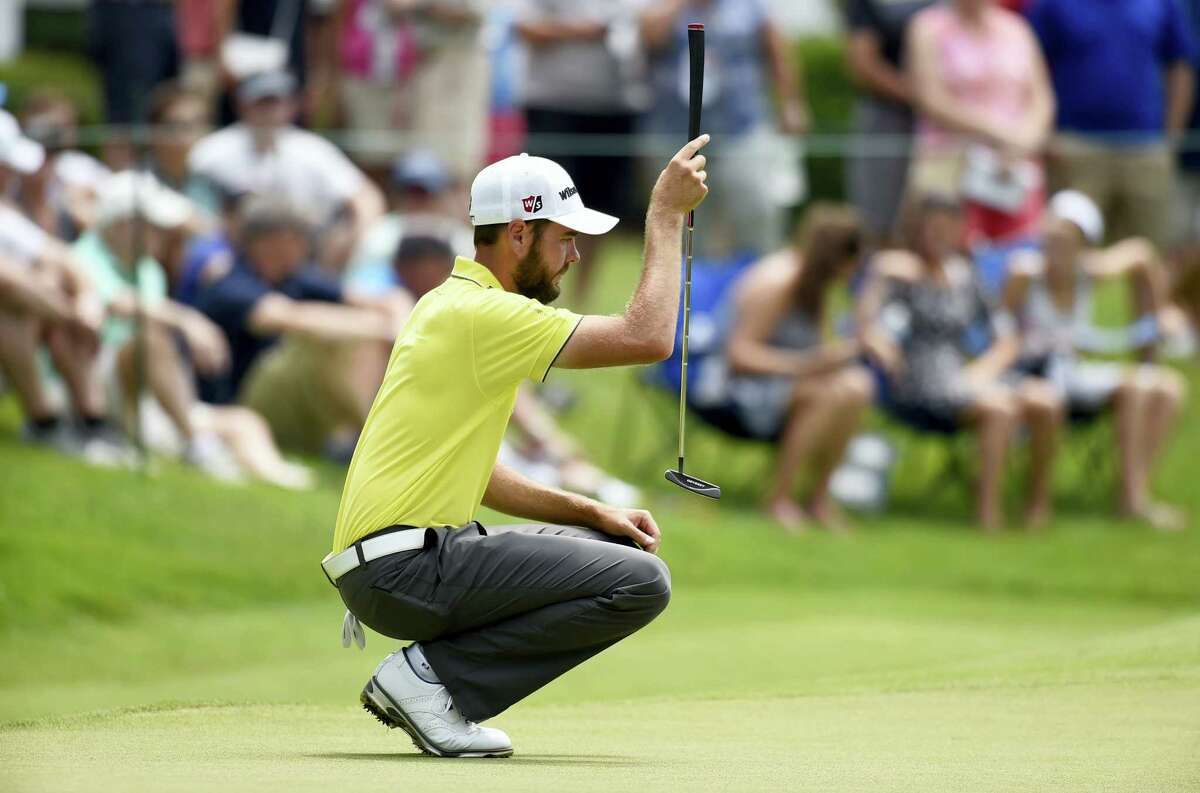 Troy Merritt lines up a putt on the eighth hole.