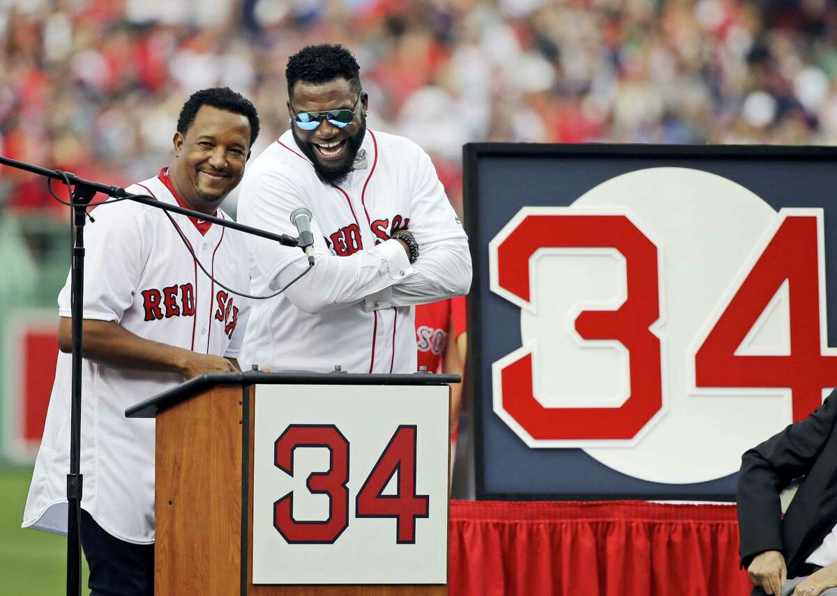 David Ortiz, right, laughs with Hall of Fame pitcher Pedro Martinez, Friday at Fenway Park.