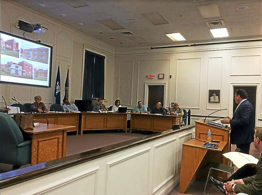 West Haven Housing Authority Executive Director John Counter addresses the Planning and Zoning Commission Tuesday night. Photo: Mark Zaretsky — New Haven Register