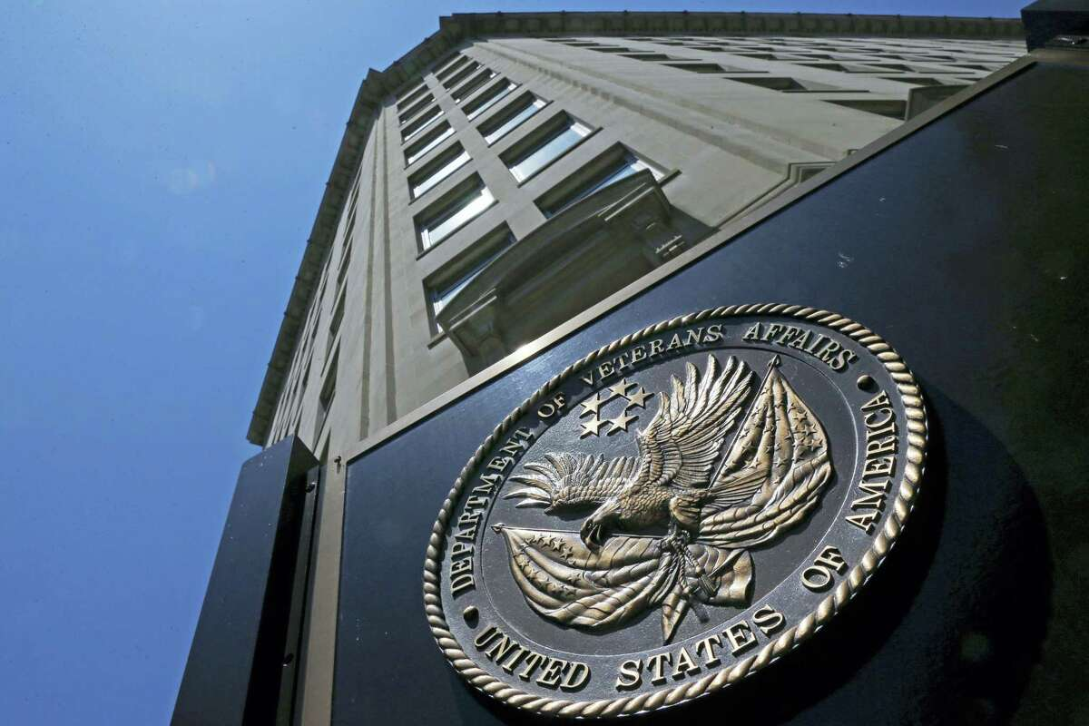 The seal affixed to the front of the Department of Veterans Affairs building in Washington. The Department of Veterans Affairs is warning of a rapidly growing backlog for veterans who seek to appeal decisions involving disability benefits, saying it will need much more staff even as money remains in question due to a tightening Trump administration budget.