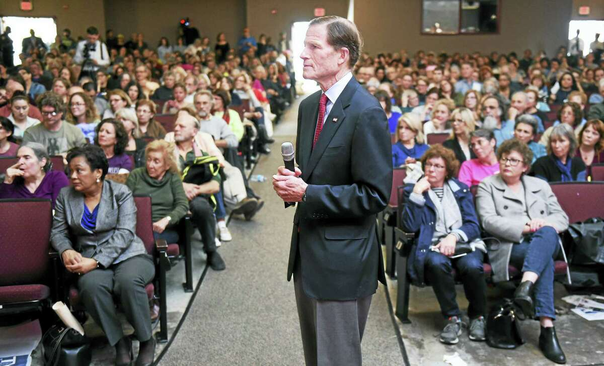 (Arnold Gold-New Haven Register) U.S. Senator Richard Blumenthal listens to a question from the audience during a Town Hall meeting at Wilbur Cross High School in New Haven on 2/25/2017.