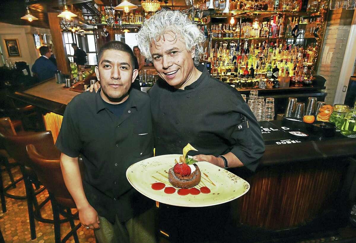 Chef Marcos Pineda, left and Chef Arturo Franco-Camacho present chocolate pavé at Geronimo.