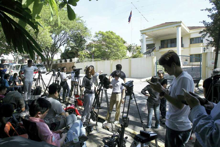 Journalists gather in front of North Korean Embassy in Kuala Lumpur, Malaysia, Saturday, Feb. 25, 2017. According to police Friday, forensics stated that the banned chemical weapon VX nerve agent was used to kill Kim Jong Nam, the North Korean ruler's outcast half brother who was poisoned last week at the airport. Photo: AP Photo/Daniel Chan    / Copyright 2017 The Associated Press. All rights reserved.