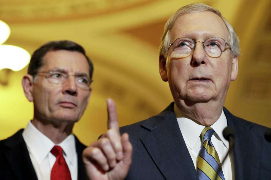 Senate Majority Leader Mitch McConnell of Ky., right, accompanied by Sen. John Barrasso, R-Wyo., meets with reporters on Capitol Hill in Washington, Tuesday, May 23, 2017, following after a Republican policy luncheon. Photo: Jacquelyn Martin — AP Photo   / Copyright 2017 The Associated Press. All rights reserved.