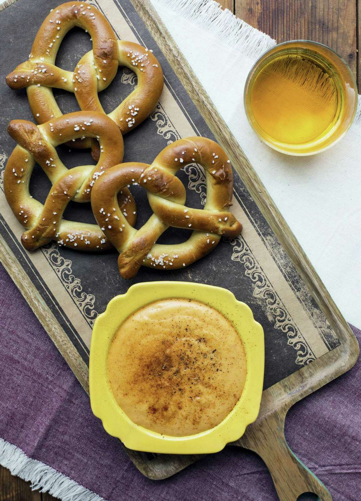 Soft pretzels with hot cheddar cheese beer dip