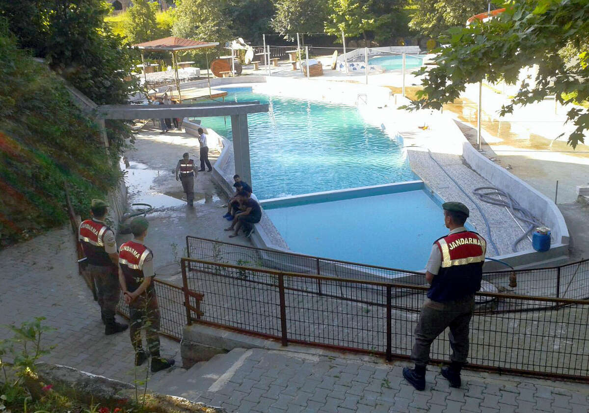Paramilitary police officers investigate after five people were caught up in an electrical current in the pool at the park in the town of Akyazi, in Sakarya province, western Turkey, Friday, June 23, 2017. Turkish media reports say five people 'three of them children' were electrocuted at a water park pool in northwest Turkey and have died.