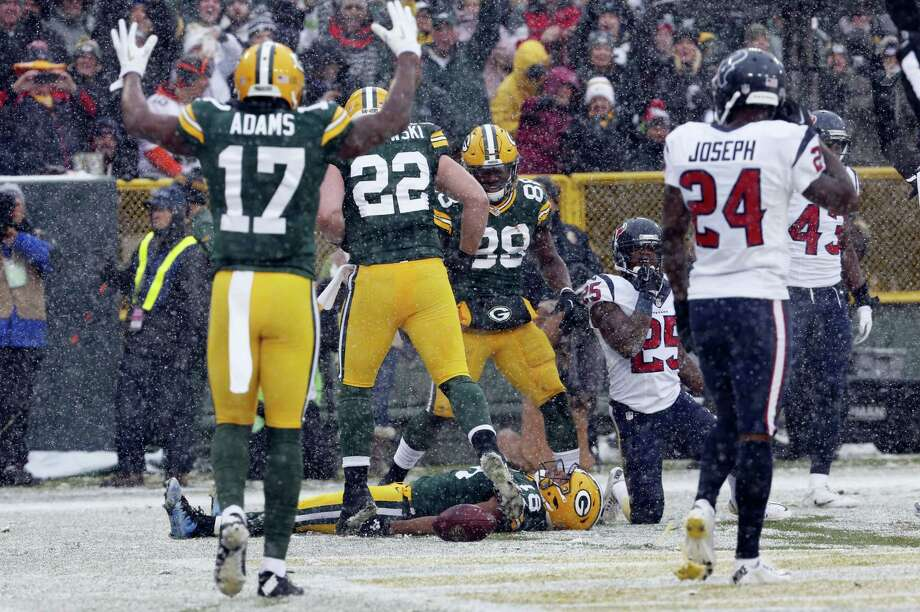 In this Dec. 4, 2016 photo, Green Bay Packers' Randall Cobb makes a snow angel after catching a touchdown pass during the first half of an NFL football game against the Houston Texans, in Green Bay, Wis. The NFL wants to put some flair back into celebrations, allowing players to use the football as a prop, celebrate as a group and roll around on the ground again if they choose. Photo: AP Photo — Mike Roemer, File   / FR155603 AP