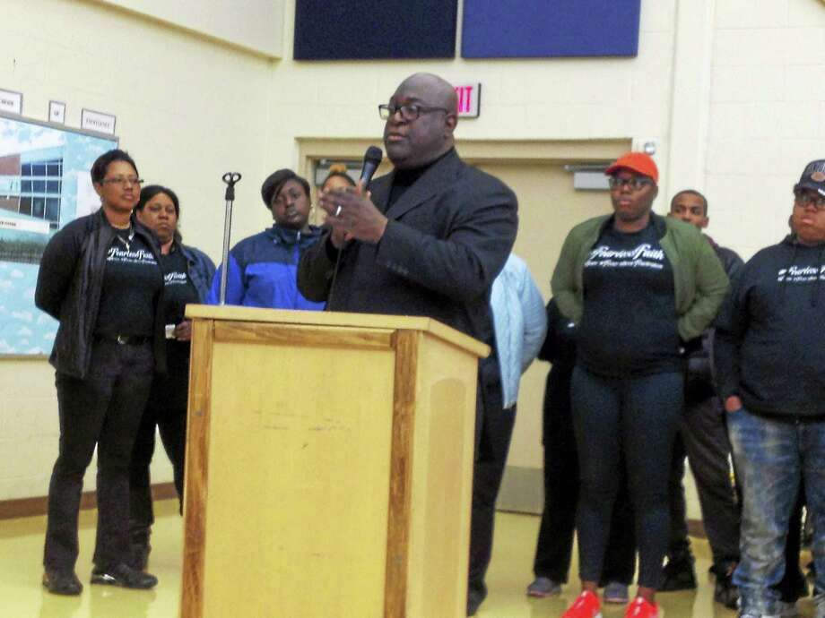 The Rev. Boise Kimber speaks at a Board of Education meeting Monday in New Haven. Photo: Brian Zahn — New Haven Register