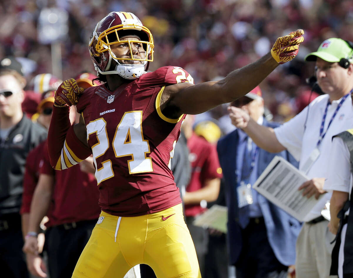 """In this Oct. 2, 2016 photo, Washington Redskins cornerback Josh Norman (24) celebrates his interception with a """"bow and arrow,"""" gesture during the second half of an NFL football game against the Cleveland Browns in Landover, Md. The NFL wants to put some flair back into celebrations. The league, however, will continue to penalize any celebration deemed offensive, including those that embarrass opponents or mimic the use of weapons."""