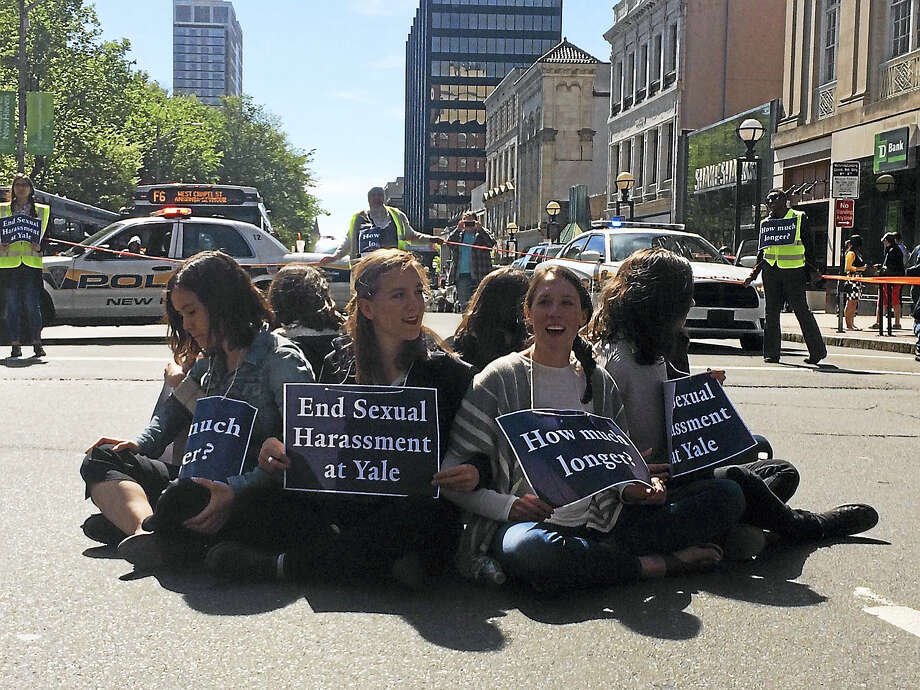Yale University Local 33 graduate student union members protest to end sexual harassment at the school, during a demonstration at the intersection of Chapel and College streets in New Haven Thursday. Photo: Jessica Lerner — New Haven Register