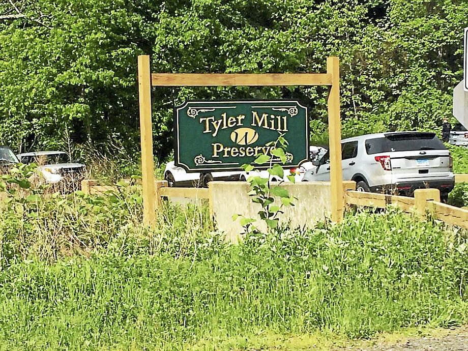 Wallingford police are at Tyler Mill Preserve on Northford Road searching for a missing person. Photo: Jessica Lerner — New Haven Register