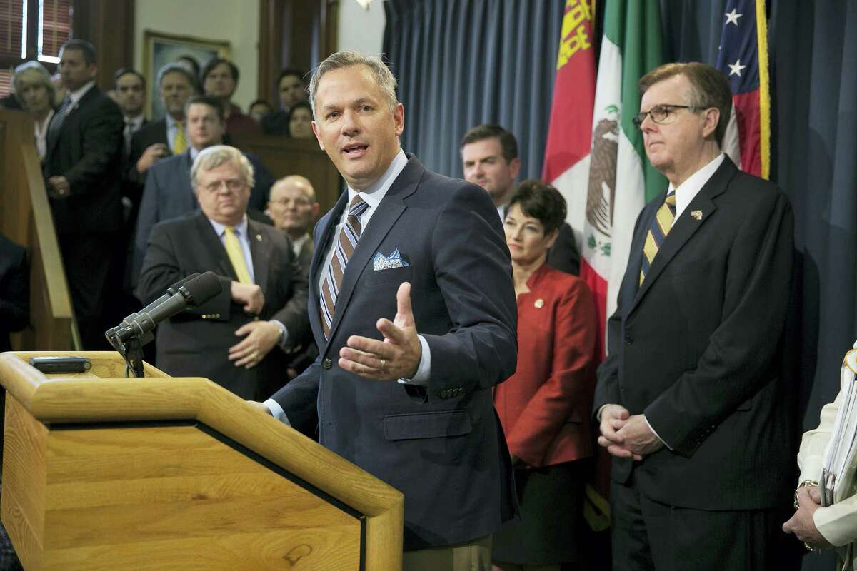 "In this March 6, 2017 photo, North Carolina Lt. Gov. Dan Forest, left, center, talks about his state's ""bathroom bill,"" at the Capitol in Austin, Texas. Texas Lt. Gov. Dan Patrick. right, looks on. Forest is a strong supporter of the bill. He has accused news organizations of creating a false picture of economic upheaval. The Associated Press has determined that North Carolina's law limiting LGBT protections will cost the state more than $3 billion in lost business over a dozen years."