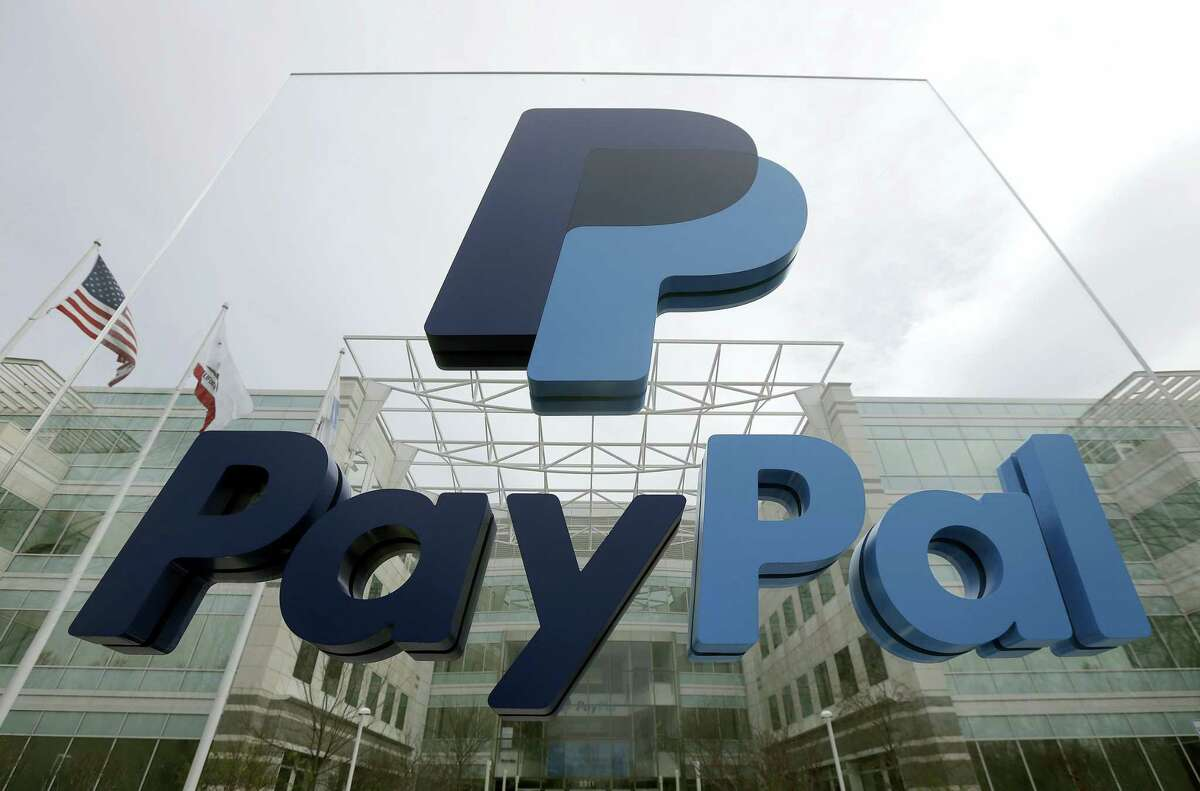 "FILE - This March 10, 2015, file photo, shows signage outside PayPal's headquarters in San Jose, Calif. The Associated Press has determined that North Carolina's law limiting LGBT protections will cost the state more than $3 billion in lost business over a dozen years. Paypal canceled plans to build a facility in North Carolina because of the ""bathroom bill."" (AP Photo/Jeff Chiu, File)"