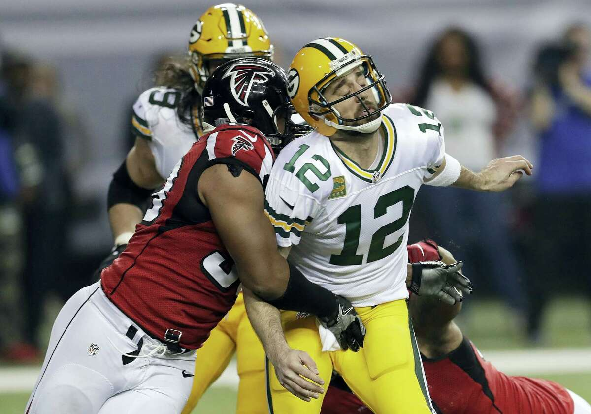 Atlanta Falcons defensive end Dwight Freeney (93) hits Green Bay Packers quarterback Aaron Rodgers after throwing a pass during the second half of the NFC championship game in Atlanta. Once the season is over, Freeney will think about his future. With his 37th birthday just weeks away, he knows time is running short.