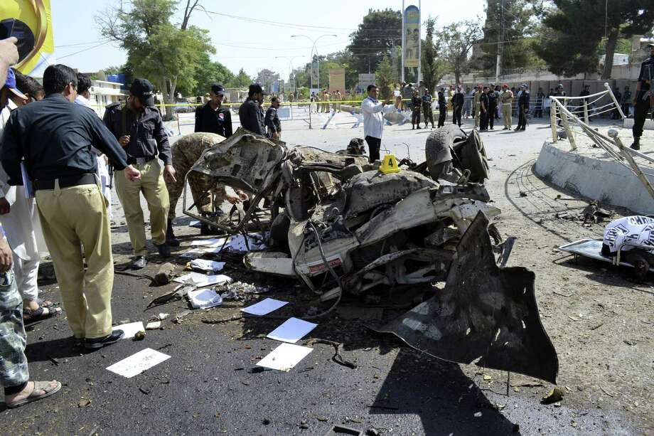 Pakistani police officers examine the site of an explosion in Quetta, Pakistan, Friday, June 23, 2017. A powerful bomb went off near the office of the provincial police chief in southwest Pakistan on Friday, causing casualties, police said. Photo: Arshad Butt / AP Photo   / Copyright 2017 The Associated Press. All rights reserved.