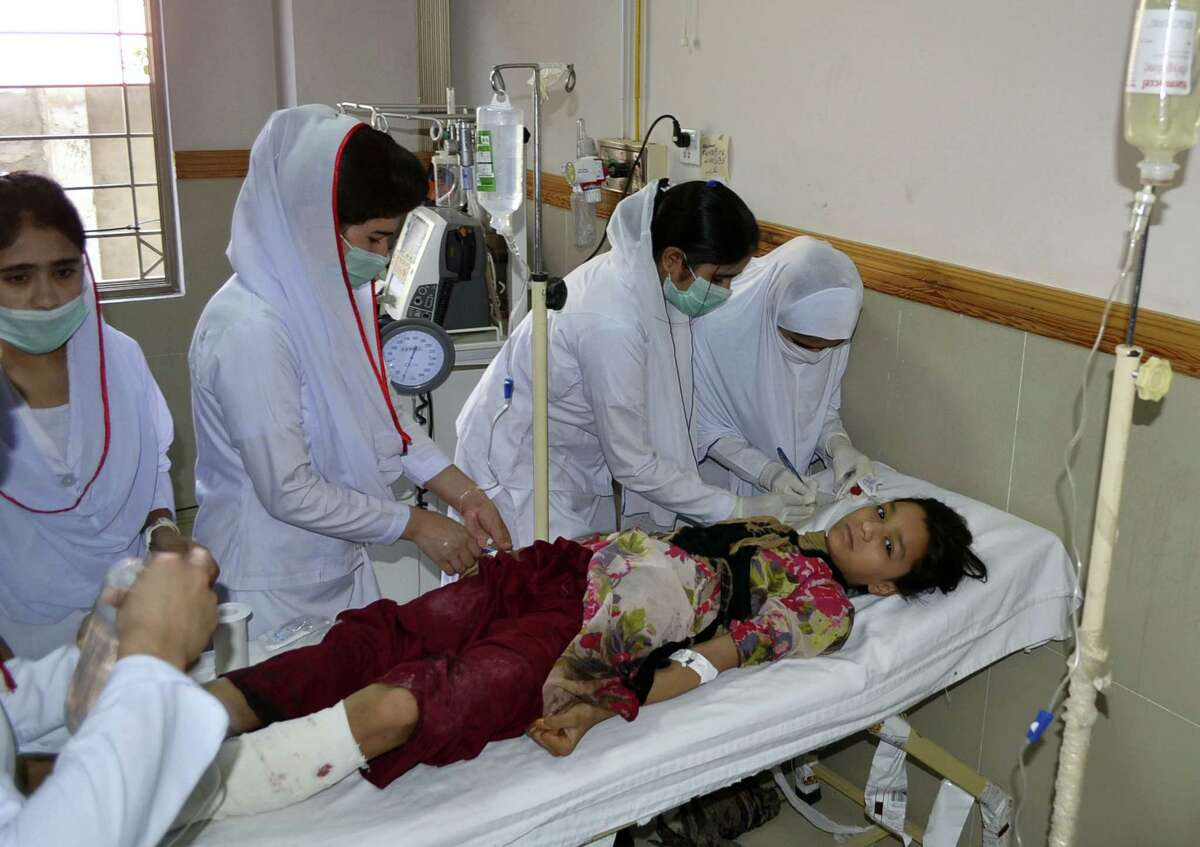 Pakistani nursing staff attend an injured girl at a hospital in Quetta, Pakistan, Friday, June 23, 2017. A powerful bomb went off near the office of the provincial police chief in southwest Pakistan on Friday, causing casualties, police said.