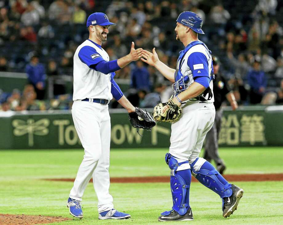Josh Zeid, left, celebrates with catcher Ryan Lavarnway after a Team Israel win in the World Baseball Classic. Photo: The Associated Press File Photo   / Copyright 2017 The Associated Press. All rights reserved.