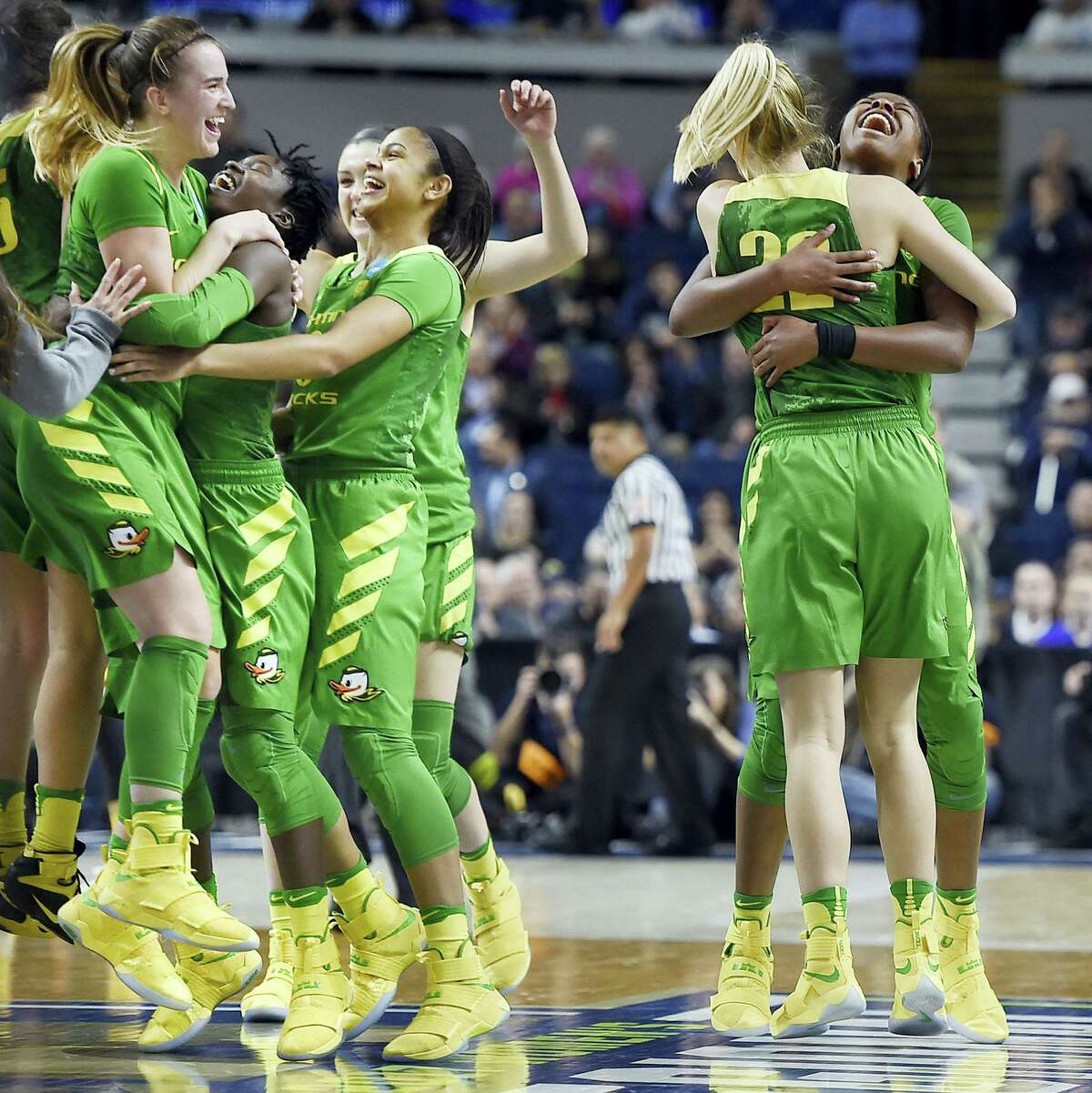 Oregon players celebrates their win over Maryland in a regional semifinal game Saturday in Bridgeport.