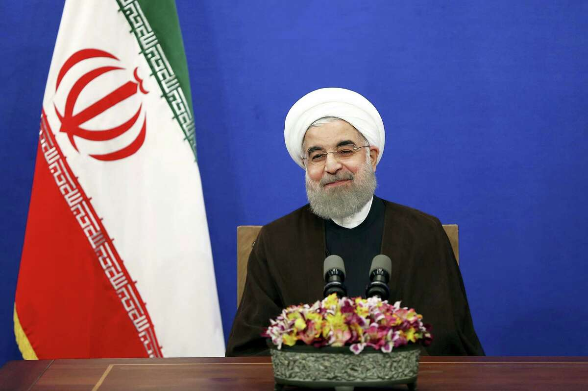 Iranian President Hassan Rouhani attends a televised speech after he won the election, in Tehran, Iran.