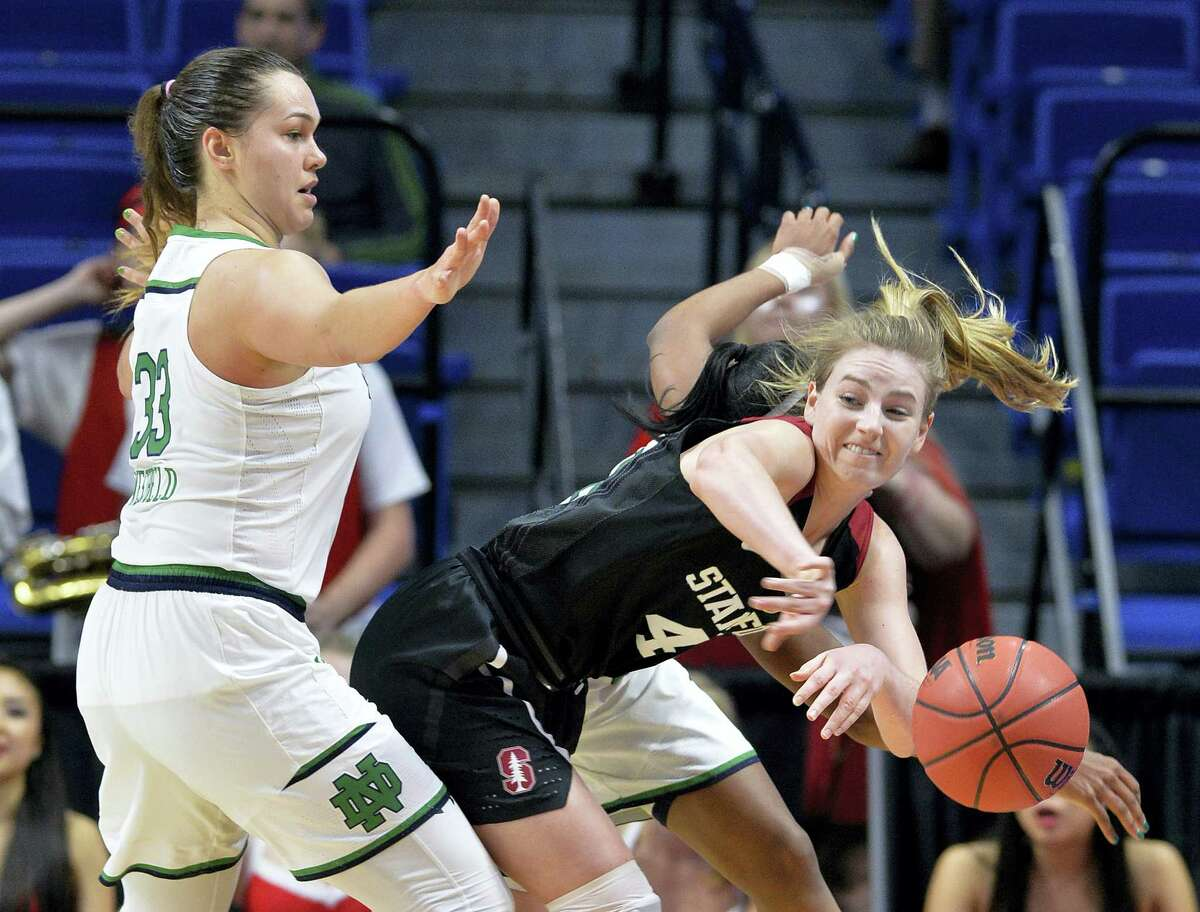 Stanford's Karlie Samuelson, center, makes a pass as Notre Dame's Kathryn Westbeld defends during their regional final game on Sunday in Lexington, Ky.