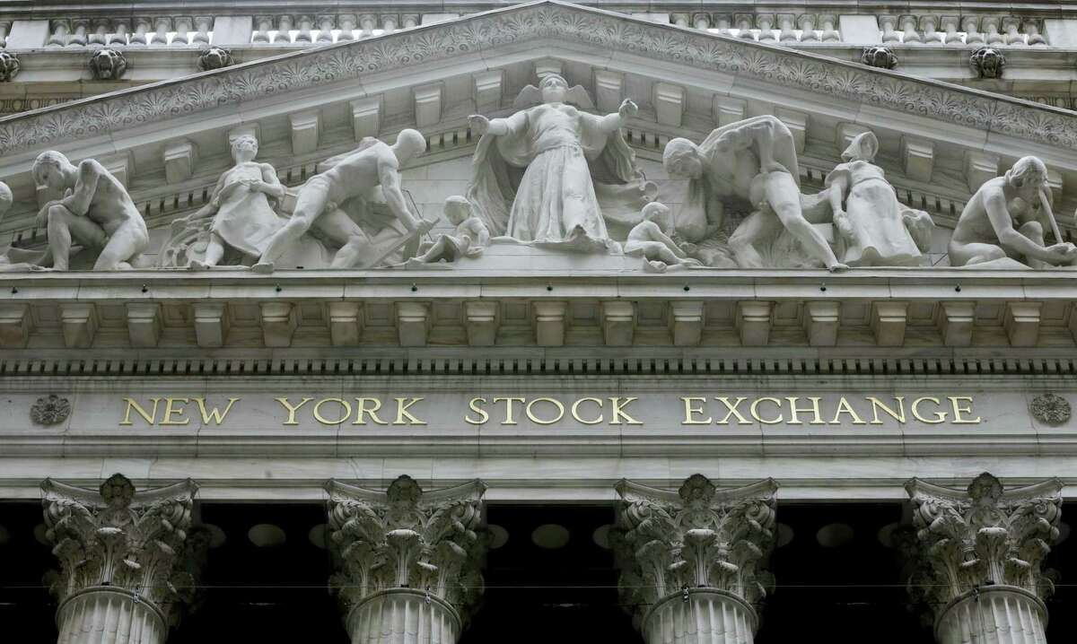 FILE - This Thursday, Oct. 2, 2014, file photo, shows the facade of the New York Stock Exchange. European stock markets eked out some modest gains Tuesday, Jan. 31, 2017, after encouraging economic figures boosted hopes that the region's recovery is gathering pace.