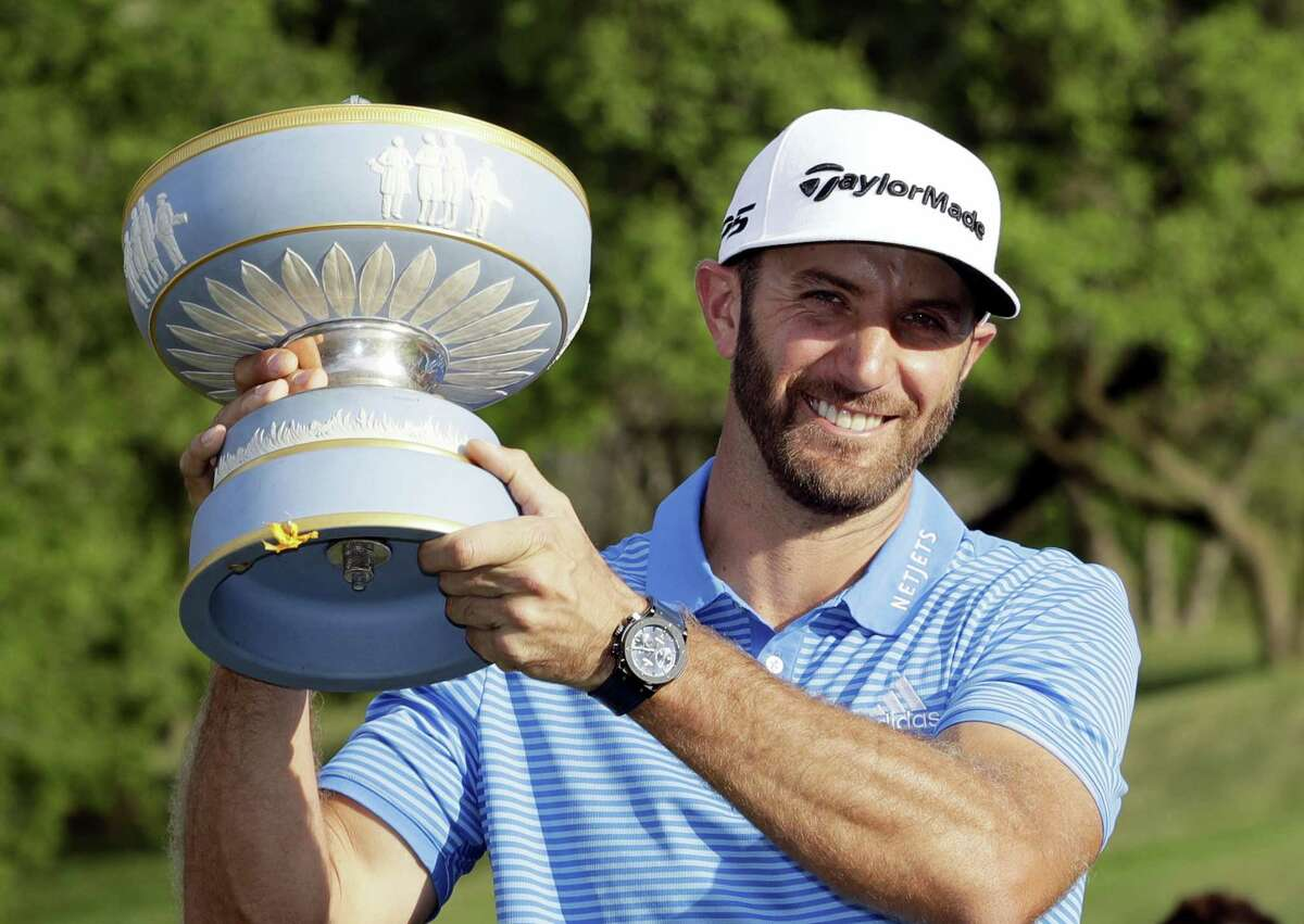 Dustin Johnson holds his trophy after defeating Jon Rahm at the Dell Technologies Match Play tournament Sunday in Austin, Texas.