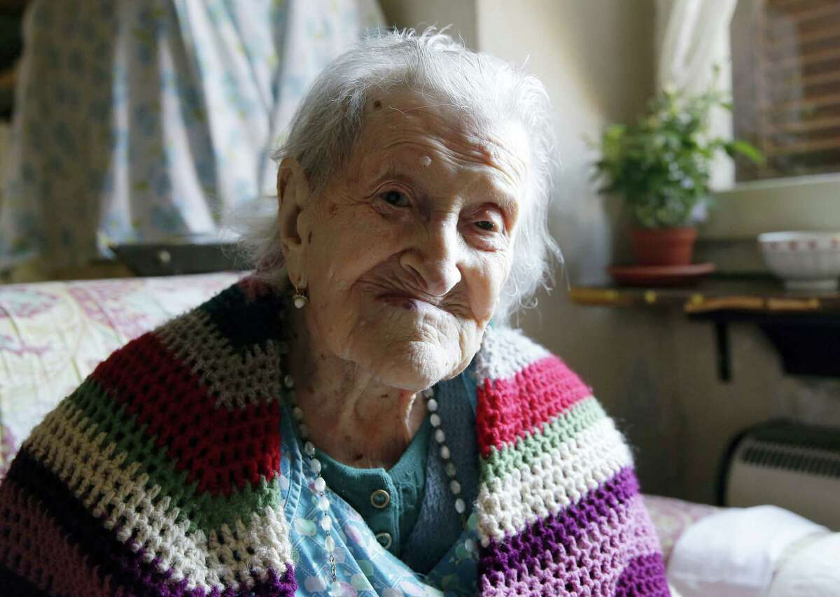 In this June 26, 2015 photo, Emma Morano sits in her apartment in Verbania, Italy. An Italian doctor says Saturday, April 15, 2017 Emma Morano, at 117 the world's oldest person, has died in her home in northern Italy. Dr. Carlo Bava told The Associated Press by telephone that Morano's caretaker called him to say the woman had passed away Saturday afternoon while sitting in an armchair in her home in Verbania, a town on Lake Maggiore.