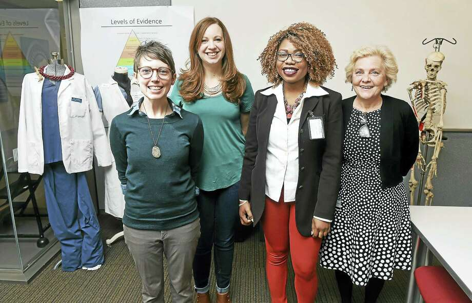 Left to right, Yale School of Nursing students Jessica Kelly-Hauser, Elizabeth Renker and Chimene Diomi with professor Linda Honan at the Yale School of Nursing in Orange. Photo: Arnold Gold — New Haven Register