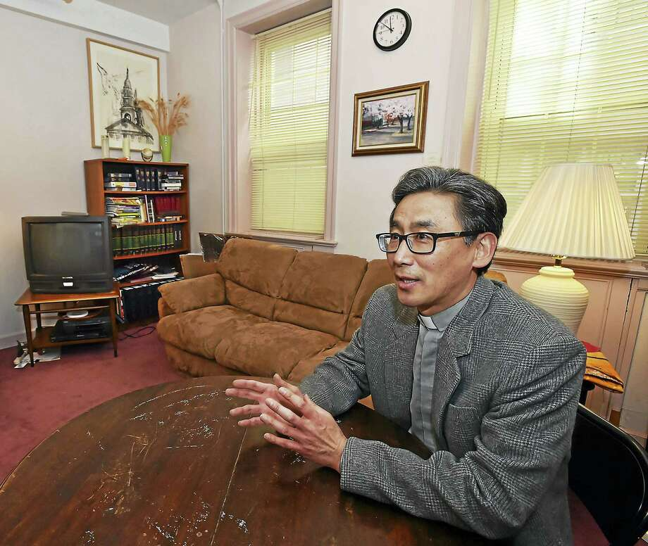 Pastor Thomas Gye Ho Kim of First and Summerfield United Methodist Church earlier this month in the church's first short-term sanctuary for immigrants facing deportation. Photo: Catherine Avalone — New Haven Register   / Catherine Avalone/New Haven Register