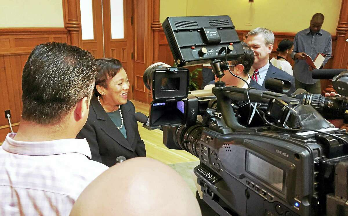 Mayor Toni Harp shares a light moment with TV journalists at City Hall during the summer preview Tuesday.