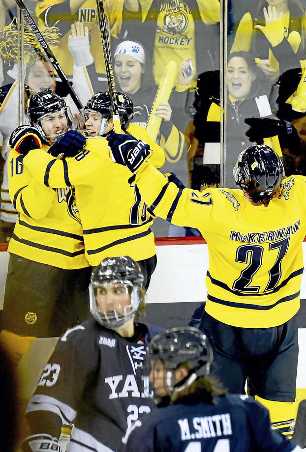Quinnipiac's Landon Smith, far left, is congratulated by teammates after scoring a goal against Yale late in the first period Friday at the TD Bank North Sports Center in Hamden. Photo: Peter Hvizdak — Register   / ©2017 Peter Hvizdak