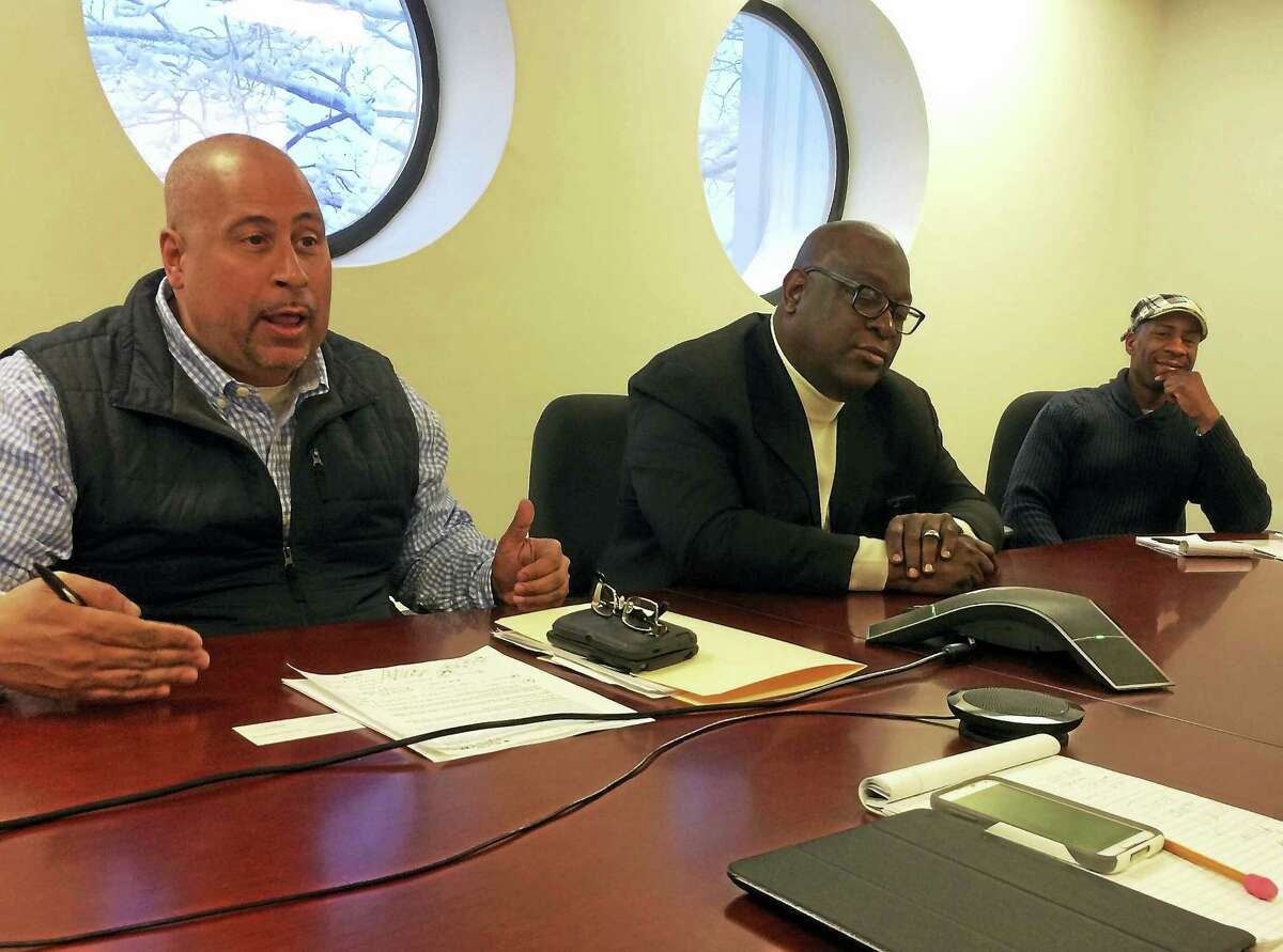 From left, Jason Bartlett, Boise Kimber and Dawud Amin speak with the New Haven Register editorial board.