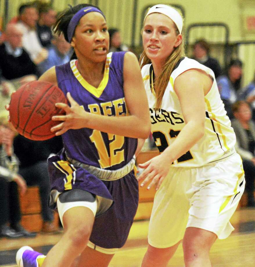 Career's Ciara Little drives against Hand's Gabby Egidio Friday in Madison. Photo: DAVE PHILLIPS ‑‑ GAMETIME CT
