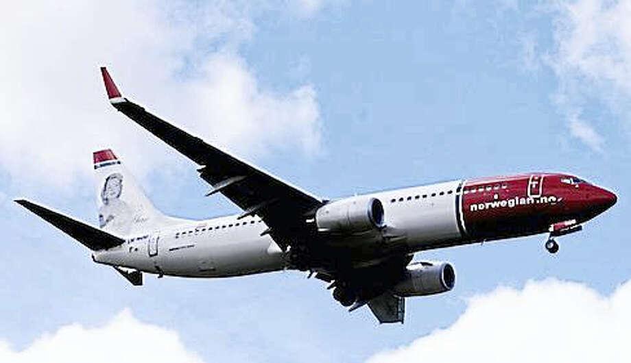 A Norwegian Air Shuttle Boeing 737-800 is seen in the air near Oslo Airport, Gardermoen in this July 17, 2009, file photo. Photo: REUTERS / Kyrre Lien / Scanpix