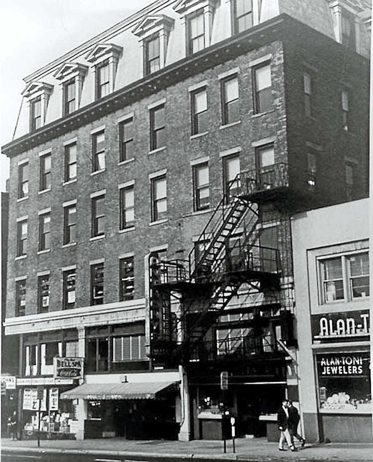 The New Haven District Telephone office and the first telephone exchange were located in New Haven, in the storefront with the awning (since demolished).
