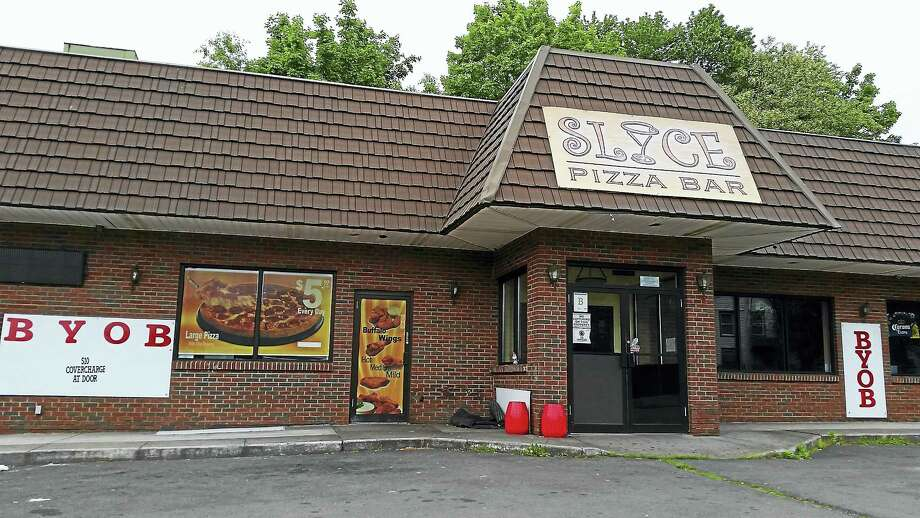 Signs hang out Slyce Restaurant is telling customers to bring their own alcohol. Photo: Kate Ramunni — New Haven Register
