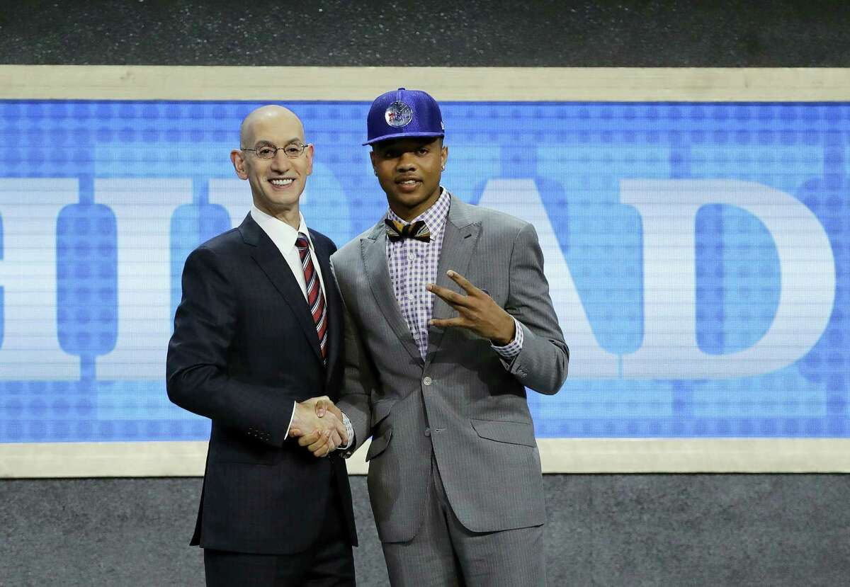 Washington's Markelle Fultz, right, poses with NBA Commissioner Adam Silver.