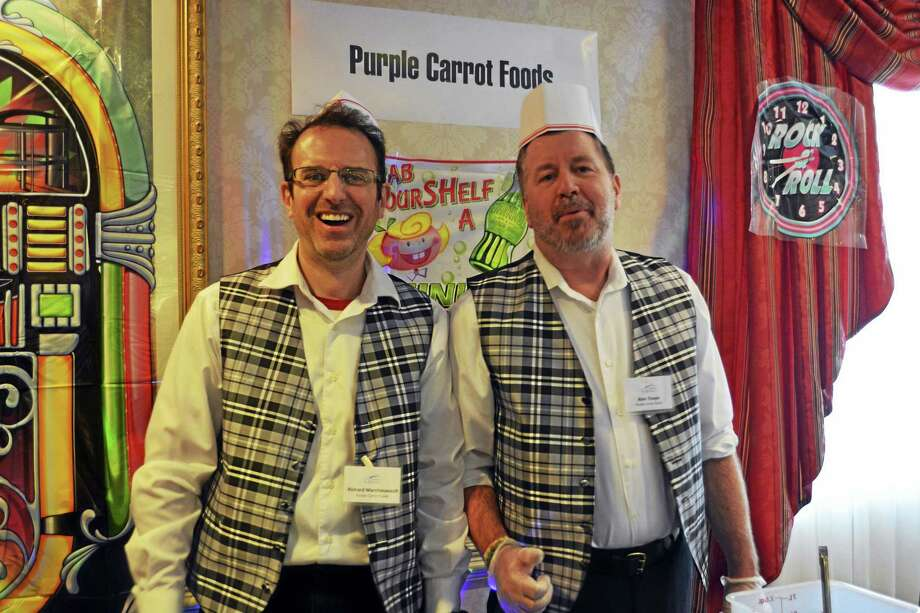 The Purple Carrot owners Richard Marchessault and Alan Thayer were among the eight chocolate purveyors who donated their concoctions to The Columbus House's annual Chocolate to the Rescue! Sunday at the Inn at Middletown. Photo: Cassandra Day — The Middletown Press