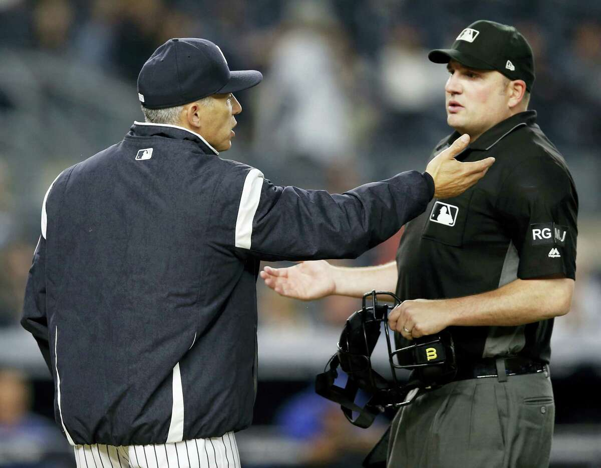 New York Yankees manager Joe Girardi, left, argues the last call with home plate umpire Dan Bellino during the ninth inning at the end of the Yankees 6-2 loss to the Kansas City Royals.